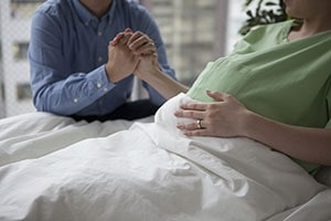 Pregnant Woman Holding Hands with her Husband
